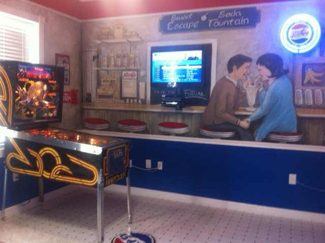 Pepsi-Cola Bedroom and Pinball Machine at The Sweet Escape Vacation Rental