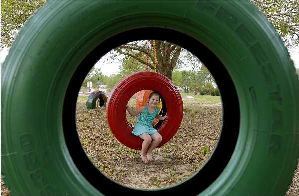 Playground and tire swings and Orlando, Florida area's Sweet Escape luxury vacation home rental