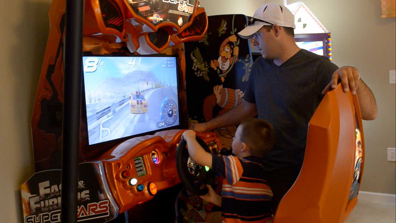 Race cars in the Fast & Furious video game at Orlando area's Sweet Escape vacation luxury home rental