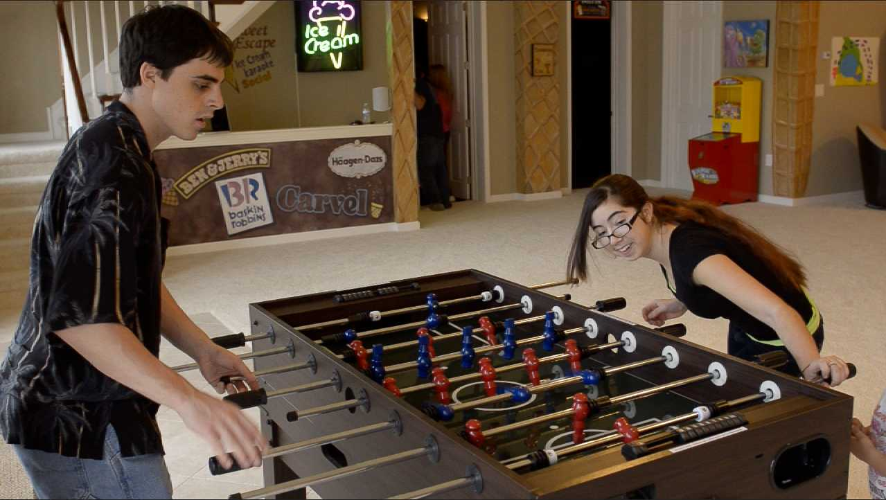 Play foosball at The Sweet Escape's video game arcade
