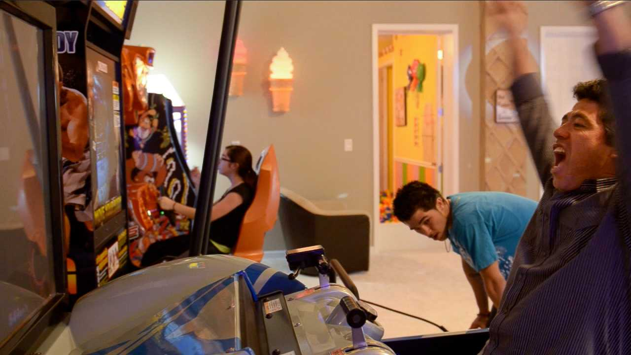 Play video games at the arcade in the Sweet Escape vacation home rental outside of Orlando!